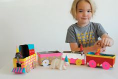 cardboard train decorated with colorful ribbons