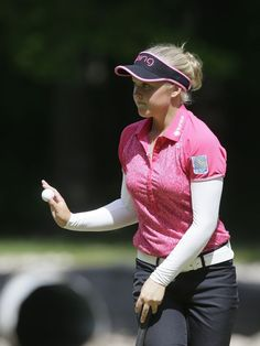 Brooke Henderson acknowledges the fans after her putt on the fourth green during the second round of the LPGA Volvik Championship golf tournament at the Travis Pointe Country Club, Friday, May 27, 2016, in Ann Arbor, Mich.  Carlos Osorio, Associated Press