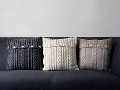 Give your living room a warm, cozy feeling this fall with cable knit pillows. #homedecor