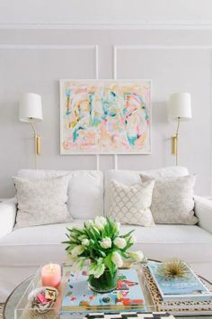 A great way to draw your attention to a fun piece of artwork. Mostly neutral with pops of color. #CLinspirationmonday  Interior Decor