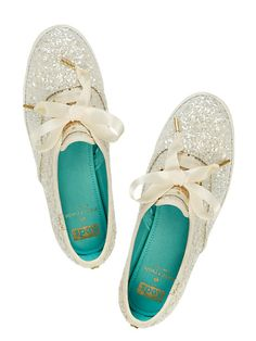to make our glitter sneakers, we took a classic-looking tennis shoe and added a heaping dose of sparkle. the result? a rubber-soled lace-up that's equally suited to the sidewalk and the dance floor.