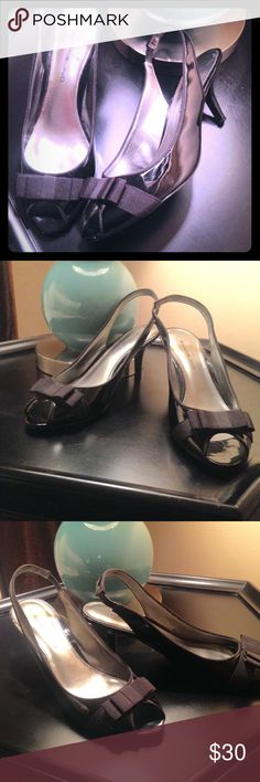 Black sling back pumps. Beautiful, lightly worn patent leather sling backs with a very comfortable heel, open toe and classy bow to finish your classic look. Bandolino Shoes Heels