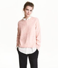 Light pink melange. Oversized sweater in a soft, fine knit with wool content. Dropped shoulders, ribbing at neckline, cuffs, and hem, and slightly longer