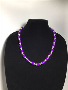 Handmade paper bead necklace accented with silver metal beads.