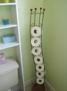 Was going to give away the cd rack because it is just gathering dust...after the bathroom remodel, we needed a place to store the paper and this was actually perfect. I love repurposing things around the house.