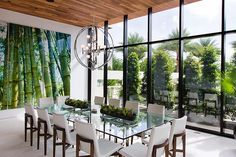 Surrounded by green dining room, the garden outside and the floor to ceiling mural inside.