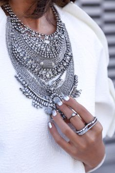 Now THIS is our kind of armor! A stunning silver bib necklace to make a few heads turn.