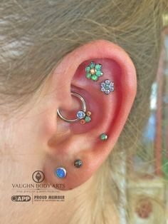 Ashleigh's ear looks amazing with all of these lovely pieces from anatometal. She had us order her some flowers and a cluster for her daith piercing, and what lovely gem combinations she. Daith Piercing, Body Piercings, Piercing Tattoo, Tiny Stud Earrings, Unique Earrings, Ear Jewelry, Cute Jewelry, Jewlery, Pretty Ear Piercings