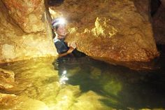 Swimming and tight corners in Actun Tunichil Muknal (ATM) Cave, Belize