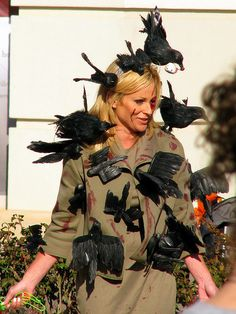 Glue fake crows onto a cheap jacket for some Alfred Hitchcock realness.