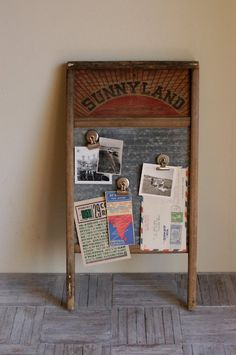 Old washboard...yes, they are magnetic!  Hang it on the wall and use it to display photos, post important messages, or to hang those bills until they pay themselves!