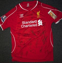 Win a 2014/15 Liverpool home shirt signed by the squad — including Mario Balotelli! #LFC