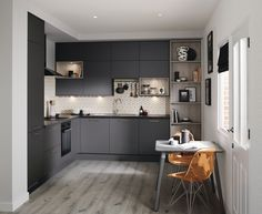 The uncomplicated design of this kitchen door lets the dark graphite colour take centre stage – perfect for a kitchen that really makes a statement. This is our Greenwich Super Matt Graphite. For more inspiration, visit Howdens. Howdens Kitchens, Grey Kitchens, Cool Kitchens, Kitchen Furniture, Kitchen Interior, Kitchen Doors, Kitchen Cabinets, Dark Grey Kitchen, Kitchen