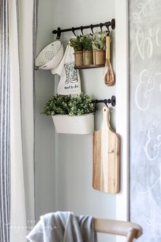 The IKEA Fintorp Rails hanging system is perfect for adding interest and dimension to any plain ol' wall! Great farmhouse decor wall vignette idea