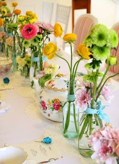 table set with colorful flowers---so sweet