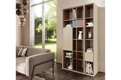 Floating shelves are a sleek, contemporary solution to dress up a blank wall while adding a little extra storage or display space. Affordable and easy to install, floating wall shelves appear to ju… Contemporary Shelving, Modern Floating Shelves, Open Bookcase, Oak Stain, Sofa, Blank Walls, Extra Storage, Box Design, Collection