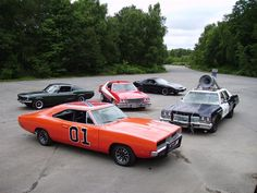 Epic meeting of TV and movie cars. Present are the General Lee from The Dukes of Hazzard, Blues Brothers 1974 Dodge Monaco, Bullitt 1968 Mustang, Starsky & Hutch 1975 Gran Torino and Knight Rider's KITT 1982 Firebird Trans Am.