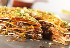 This hearty, one-dish meal features layers of ground beef, tortillas,enchilada sauce,refried beans and shredded Cheddar cheese...it's a wonderfully satisfying dish.