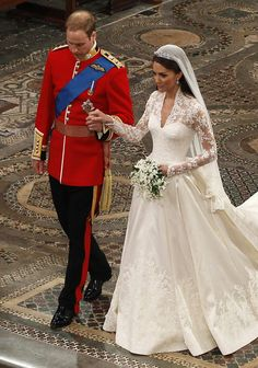 Prince William takes the hand of his bride Catherine Middleton, now to be known as Catherine, Duchess of Cambridge, as they walk down the aisle inside Westminster Abbey on April 29, 2011 in London, England.