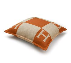 "Avalon Hermes cushion in ecru/pumpkin. 85% wool, 15% cashmere.Removable cushion, dacron inside. Cover measures 27.5"" x 27.5"", pillow measures 24.5"" x 24.5""."