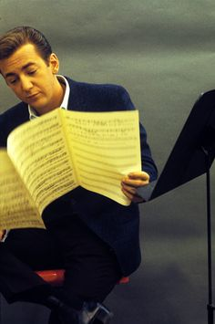 Bobby Darin reading sheet music and looking tired