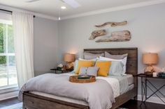 Master Bedroom, AFTER As elsewhere, the design was kept relaxed and calming in the bedroom with a cool, soothing palette and simple details that tied together to create distinct but nuanced references to the beach and ocean.