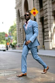Blue suit, pink shirt/pocket square, blue shoes, and brown shoes.