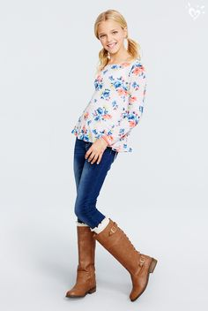 A flowy top goes perfectly with skinny jeans. The final touch: a pair of boot socks peeking over the top of so-now riding boots!