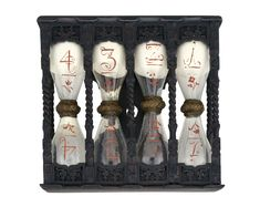 "17th century German Hour-glass at the National Maritime Museum, London - From the curators' comments: ""A four-fold glass with 15-, 30-, 45- and 60-minute glasses. The glasses bear the numbers 1, 2, 3 and 4 in red paint on each bulb, indicating the number of quarter-hours measured. There is also a flower painted on each bulb in red paint. They are filled with a white substance that is possibly ground eggshell. The central joints are bound with twine."""