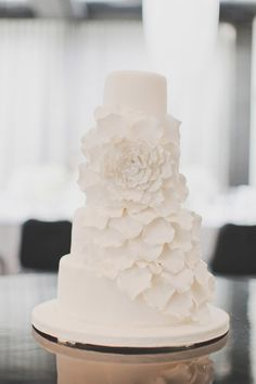 an all white stunner of a cake by http://www.juditmeron.co.nz/  Photography by http://katemacpherson.com