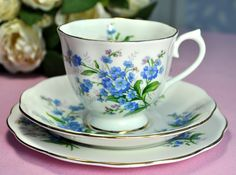 Royal Abert Forget-Me-Not vintage teacup, saucer and tea plate.  A Royal Albert countess shape vintage bone china tea trio with a pretty blue forget-me-not flowers design. Gold gilding around the rims.  There is a little forget-me-not flower on the inside of the teacup.  Vintage china in excellent condition with a miniscule amount of wear to the gold gilding around the teacup rim.  The tea plate is 16cm diameter. Backstamp: Royal Albert. Bone China. England. Forget-Me-Not. Made by Thomas C…