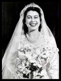 Queen Elizabeth II wearing The Hanover Russian Fringe tiara on her wedding day, November 20, 1947    (photo by Popperfoto/Getty Images via National Geographic)