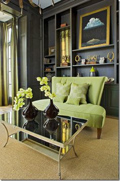 dark charcoal walls, pale green sofa
