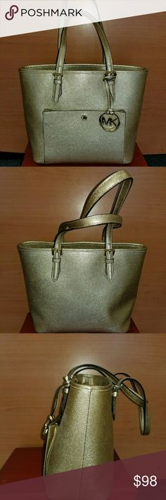 Nwot gold med Mk Super cute shimmering gold med Mk nwot. Lots of pockets and space. Front pocket opens to hold cards and more.  No dust bag.Cleaning out Authentic as always. Ty foe shopping in my closet. Michael Kors Bags Shoulder Bags