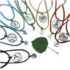 """A set of seven chakra necklaces, one for each chakra. 0.8"""" (2 cm) chakra pendants dangle sweetly on a vegetarian microfiber suede necklace with clasp."""