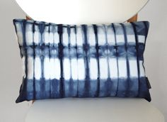 Tie Dye Shibori Pillow Cover 12x18 inches  by SeaAndStoneStudio, $60.00 CAD    • 100% organic cotton twill  • sized for a 12x18 inch pillow form - cover is slightly smaller to ensure a plump fit  • one continuous piece of hand dyed shibori fabric - design is on both sides  • invisible zipper  • machine wash, tumble dry  • ready to ship    This listing is for one pillow cover only, pillow form not included.