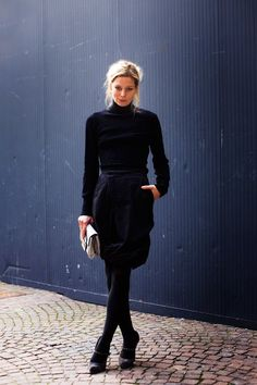 Black turtleneck and skirt combo.