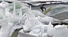 Surfer Rides Standing Wave in Icy German River