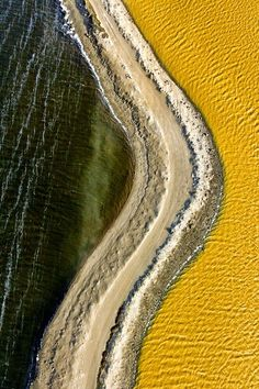 Supernatural colors and incredible shades captured by Chris Benton flying over the salt lakes of South Bay California.