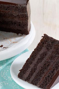 Favorite Fudge Birthday Cake - This quadruple-layer cake isn't nearly as fussy to make as you might think. It starts out as a standard two-layer cake, then each layer is cut in half and stacked, with an easy filling in between the layers. The result is a moist cake that keeps well without refrigeration; looks spectacular when cut, and tastes even better than it looks!
