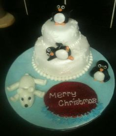 Another Christmas cake for a local dance group: dancing penguins!  (Chocolate with vanilla cream.)  By Lady T Cakes.
