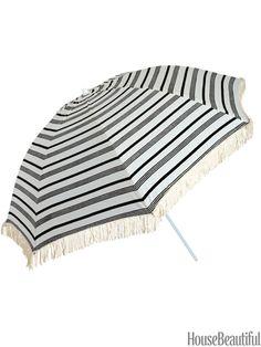Beach umbrella. By Kerry Cassill Home. housebeautiful.com. #beach_umbrella #umbrella #stripes #nautical