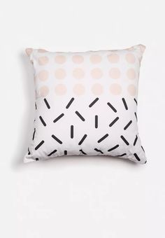 A beautiful combination of shape and colour, this scatter cushion has little black lines on the one half and pretty pink polka dots on the other. A confident little design, it's sure to breathe fresh life into your living area.
