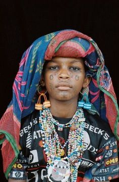 Africa | Portrait of a young Wodaabe woman with facial tattoos and a headscarf, Niger  | © Marie-Laure de Decker