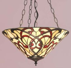 The Ruban art nouveau tiffany range of lighting by Interiors 1900 includes a simple single upward facing shade ceiling light pendant with flowing ribbons of coloured glass. Available from Luxury Lighting