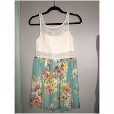 Cute spring dress! Crochet on top. With see through torso. Floral chiffon on bottom part of dress. Dresses Mini