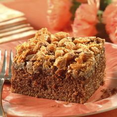 Looking for a new dessert for your family? This Crumble-Topped Chocolate Peanut Butter Cake has the perfect combination of flavors and is topped with tasty candy crunchiness. Great for all occasions.