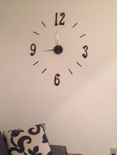 DIY wall clock -$12 clock kit from Walmart -Wooden numbers painted gold and black -Adhesives from kit used for notches