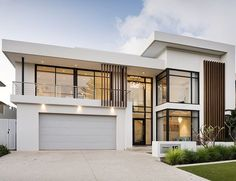 This stunning contemporary two-storey home has been shaped to fit the contours of a sloping block, harness ocean views, create a north-facing backyard sanctuary for year-round enjoyment and deliver well-zoned accommodation for a family of five. Modern Exterior House Designs, Modern House Facades, Dream House Exterior, Modern Architecture House, Modern House Plans, Modern House Design, Architecture Design, Modern Home Exteriors, Home Building Design