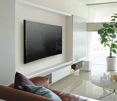 Sliding doors to hide the TV and good unit underneath